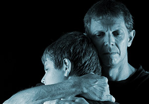 Father crying as he hugs his son [Image © Three Rocksimages - Fotolia.com]