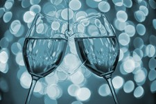 Two wine glasses and heart against nightclub lights [Image © MariaBobrova - Fotolia.com]
